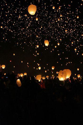 Illuminated lights against sky at night