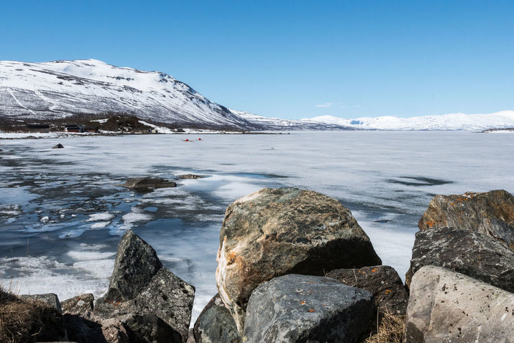Abisko Shore 1 Abisko Beauty In Nature Blue Clear Sky Cold Temperature Day Frozen Glacier Ice Iceberg Mountain Nature No People Outdoors Rock - Object Scenics Sea Sky Snow Sweden Tranquil Scene Tranquility Water Winter