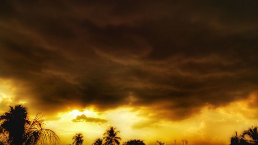 Burning Cloud - Sky Sunset Silhouette Nature Sky Scenics Low Angle View Beauty In Nature Cloudscape No People Outdoors Tranquility Storm Cloud
