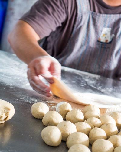 Close-up of person preparing food chapatti