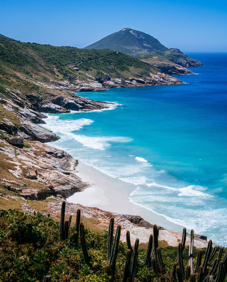 Water Scenics - Nature Sea Beauty In Nature Tranquil Scene Mountain Tranquility Land Beach Sky Nature No People Blue Idyllic Day Non-urban Scene Coastline Plant Remote Outdoors
