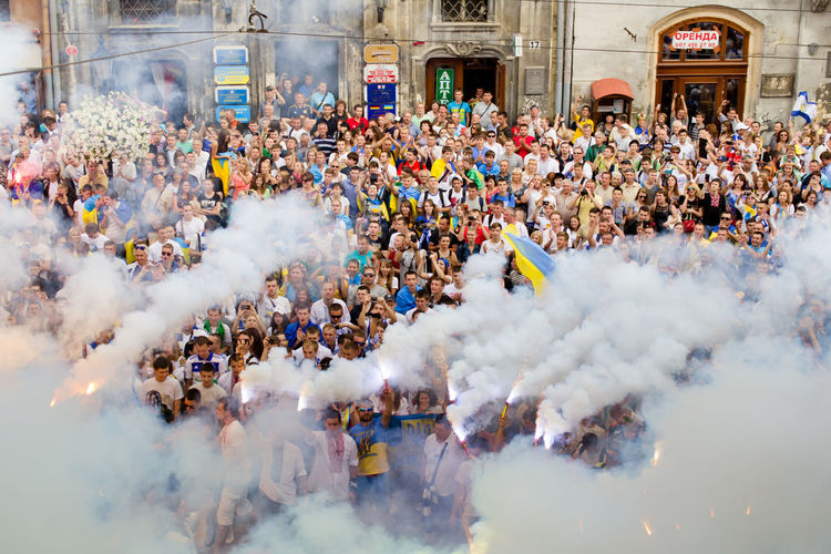Abundance Celebration Change Crowd Cultures Day Enjoyment Fans Football Footbollfans L'viv Large Group Of People Lifestyles Men Motion Outdoors Patriots  Real People Selective Focus Smoke Spirituality Steam Togetherness Ukraine Ultras
