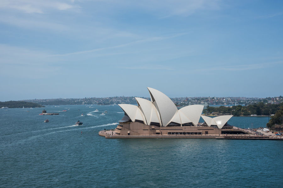 Sydney,NSW,Australia-November 20,2016: Elevated view over the Sydney Opera House at Bennelong Point in Sydney, Australia 20th Century Architecture Australia Cityscape Harbour Roof Sydney Cove Sydney Opera House Tourist Tourist Attraction  Transportation Venue Arts Culture And Entertainment Bennelong Point Boat Building Exterior Elevated View Expressionist Landmark Motion Nautical Vessel Sydney Travel Destinations Wake Water