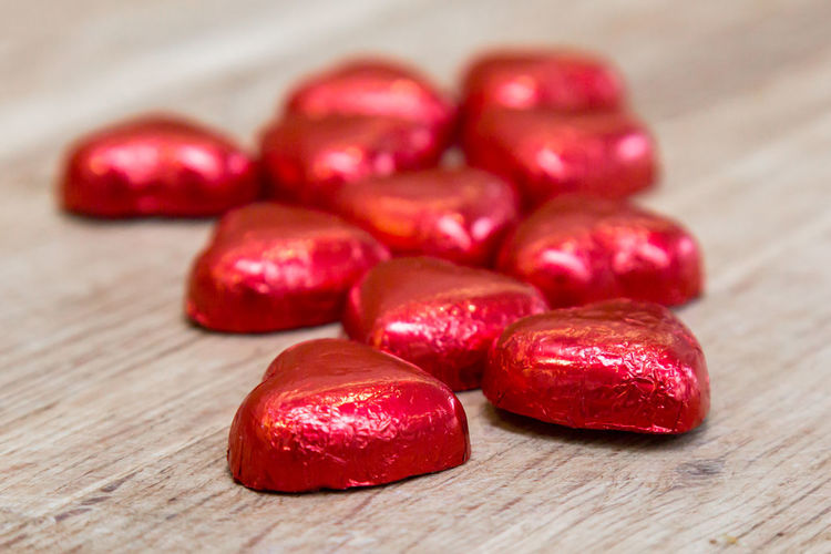 Close-Up Of Red Chocolates On Table