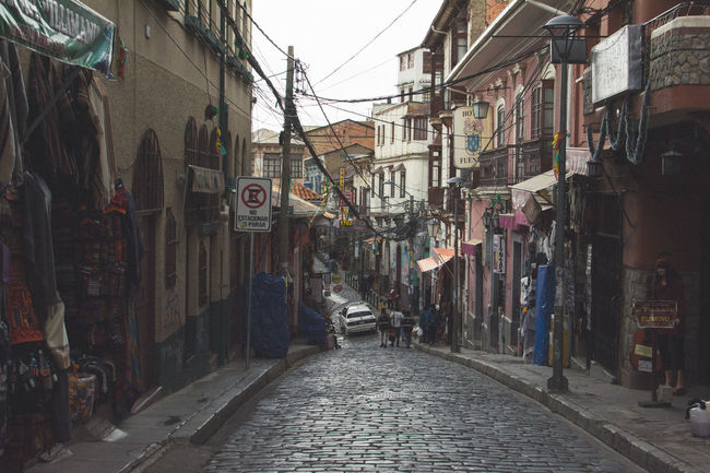 Building Exterior Architecture Built Structure The Way Forward Street Cobblestone Narrow Residential Structure City Long Surface Level Day Diminishing Perspective Residential District Alley Footpath Bolivia La Paz La Paz, Bolivia Witches Market Narrow Footpath Building City