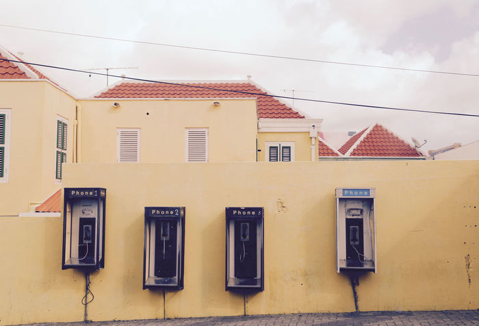 Architecture Building Exterior Built Structure Call Me Communication Curacao No People Otrabanda Outdoors Phonebooth Phonebox Residential Building Residential Structure Telephone Town Yellow ın A Row
