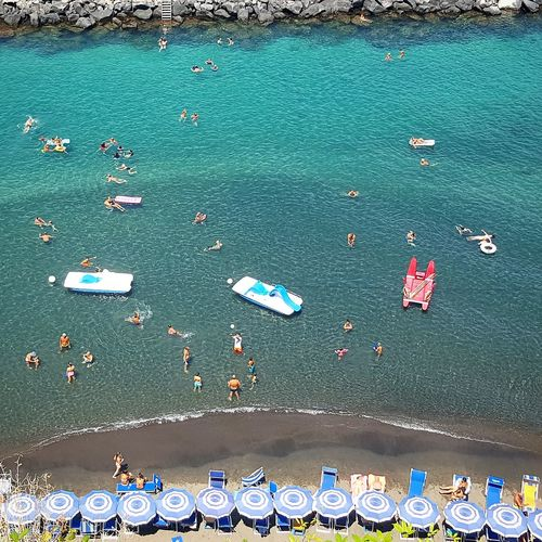 Aestas, 2018 DC - homines in aqua. Summer Summertime People People Watching People Photography people and places Swimming Swimming Time Swimmingtime Italy Sorrentocoast Sorrento Sorrento, Italia Sorrento Sea Beautiful Nature Beautiful People View Water Beach Sea Nautical Vessel High Angle View Aerial View Pedal Boat Water Sport Beach Umbrella Sandy Beach Sand Parasol Sun Lounger