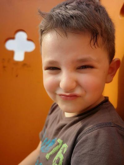 Portrait of smiling cute boy making a face