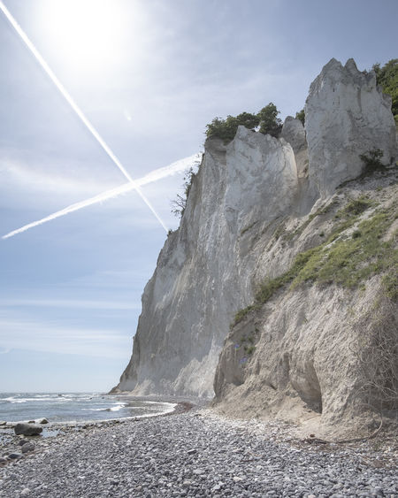 Chalk Cliffs of Möns Klint with crossed vapor trails. Beach Beauty In Nature Cliff Cloud - Sky Day Island Møn Land Møns Klint Nature No People Outdoors Rock Rock - Object Rock Formation Scenics - Nature Sea Sky Solid Sunlight Tranquil Scene Tranquility Vapor Trail Water