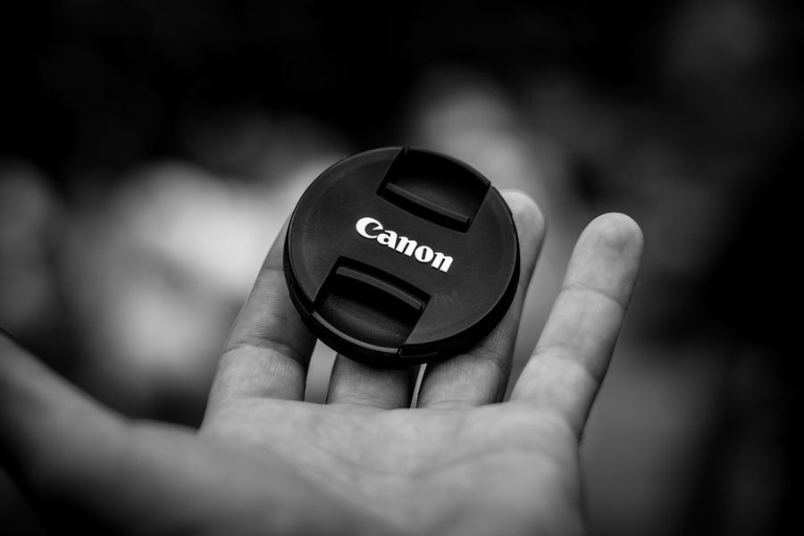 eyelid // Lens Cap Black And White Blackandwhite Bnw Bnw_friday_eyeemchallenge Canon Canon_official Canonphotography Close-up Communication Display Eyelid Fingers Hold Holding Human Body Part Human Finger Human Hand Lens - Eye Lenscap Photographer Technology An Eye For Travel