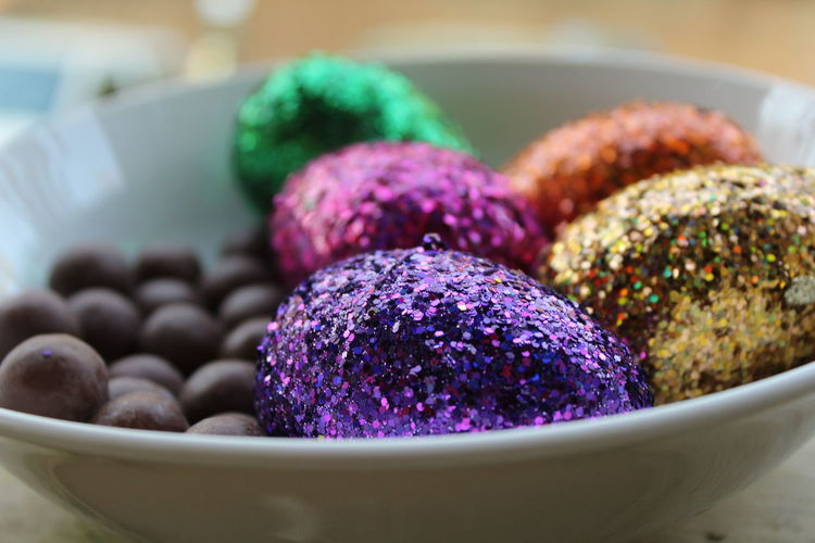 Close-up of dessert and easter eggs in bowl on table