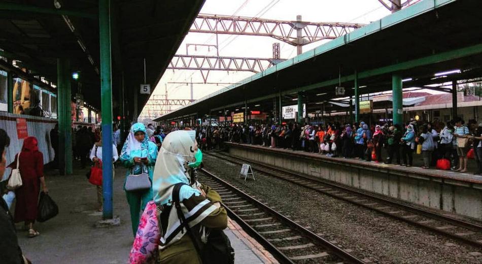 People waiting at railroad station platform