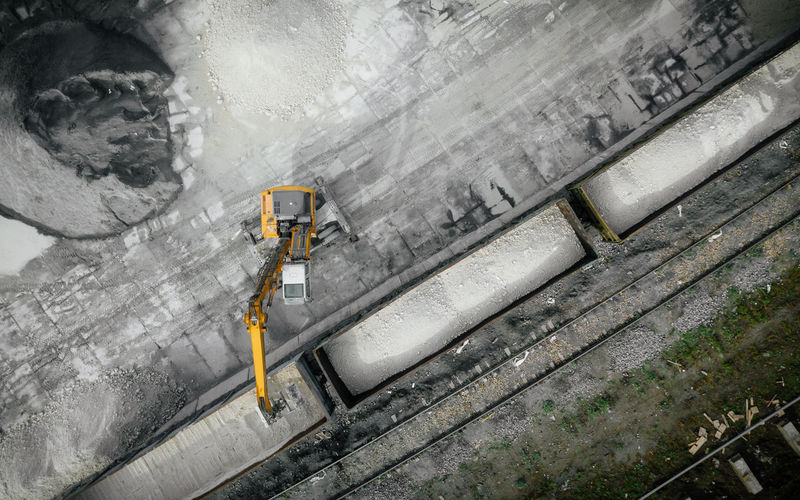 High angle view of worker working on wall