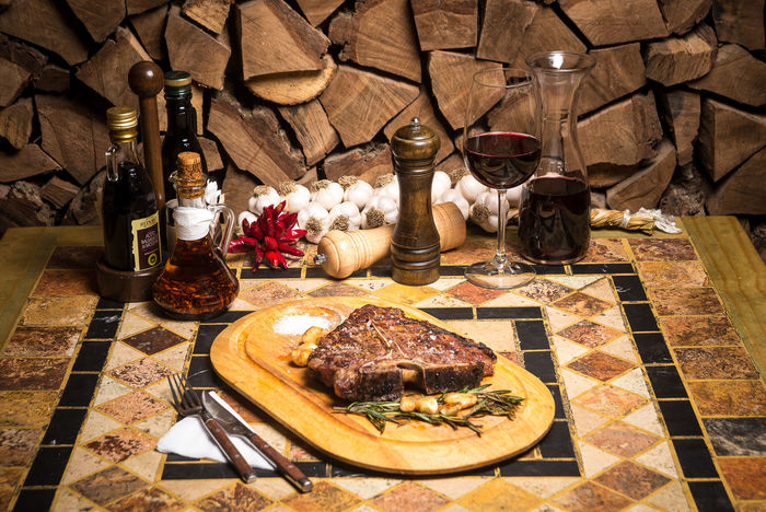 Beef Beef Steak Cooking Dinner Beefsteak Bottle Cutting Board Day Food Food And Drink Freshness Indoors  Meat No People Plate Ready-to-eat Restaurant Serving Dish Spice T-bone T-bone Steak Table Wine Wineglass