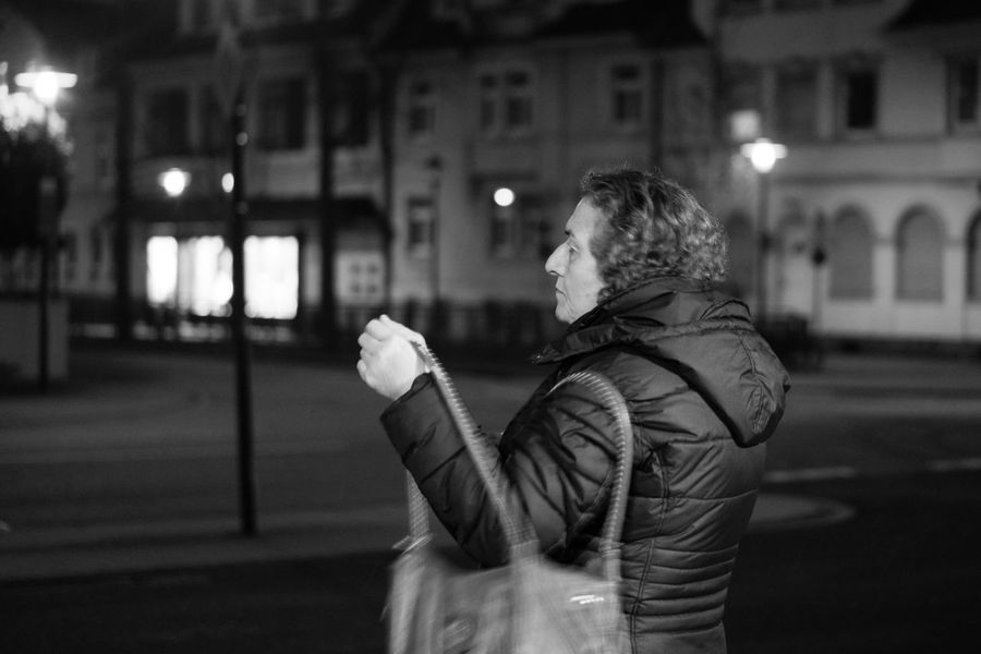The grandma with her bag Adult Architecture Bag Building Exterior Built Structure Bühl Camera City Germany Grandma Illuminated Lady Lifestyles Night One Person Outdoors Real People Samsungphotography Streetphotography Warm Clothing Winter Woman