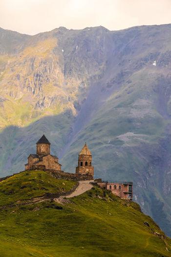 Historic building against mountain range