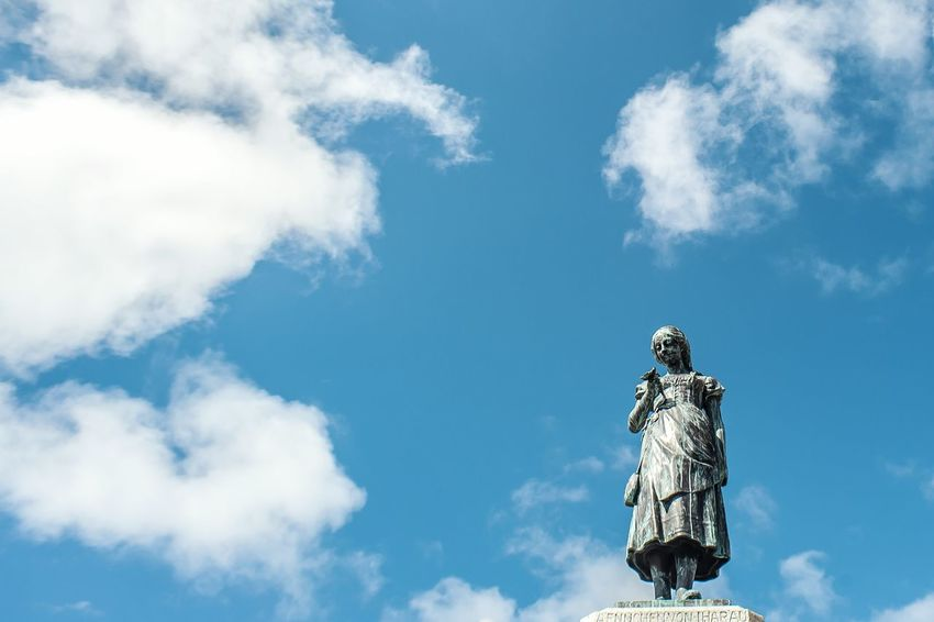 Sky Low Angle View Cloud - Sky Statue Day Outdoors Performance No People Fighter Plane Aerobatics Motorsport Memel Klaipeda Oldtown Anike Lithuania Europe City Center Baltic Countries Torism Girl Statue Lithuania Travel Tourism Oldtown Oldcity Summer