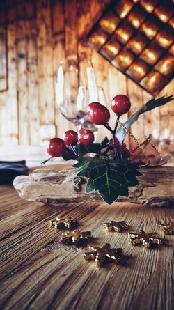 Christmas dinner table decoration Christmas Decorations Table Decoration Wineglass Gold Wooden Table Warm Feeling Gold Tones