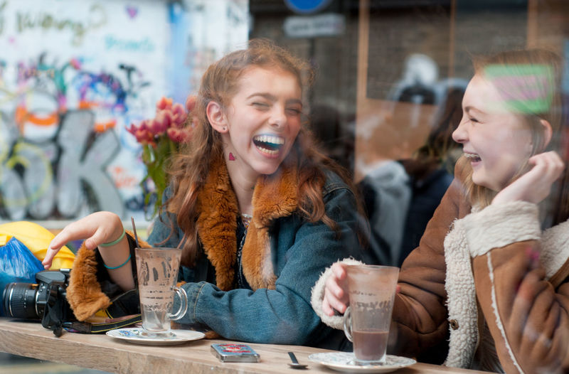 Blond Hair Bonding Cafe Cheerful Coffee - Drink Customer  Day Drink Drinking Enjoyment Food And Drink Friendship Fun Happiness Indoors  Leisure Activity People Portrait Real People Sitting Smiling Table Togetherness Young Adult Young Women The Street Photographer - 2017 EyeEm Awards