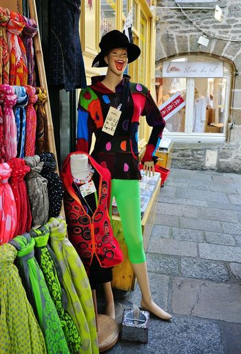 Happy Laughing Street Photography Colorful Clothing Store Model Mannequin Sunshine Summertime Holidays Dinan Shop Window Sales Discount France🇫🇷 Stone Buildings Stone Pavement