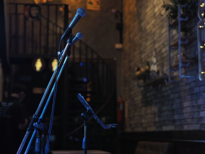 microphone. Restaurant Night Club Arts Culture And Entertainment Music Night No People Musical Instrument Electric Guitar Outdoors Club Night Drink Time Musical Photos Multi Colored Lifestyles Pub Party - Social Event Lowlight Bar&restaurant Microphone City Recording Studio Modern
