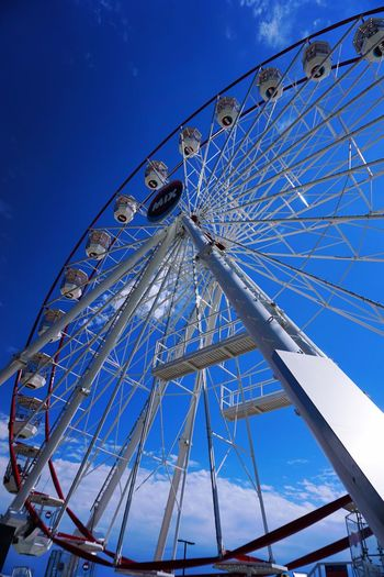 Amusement Park Ride Amusement Park Ferris Wheel Arts Culture And Entertainment Low Angle View Sky Blue Clear Sky Large Geometric Shape Circle Outdoors Day