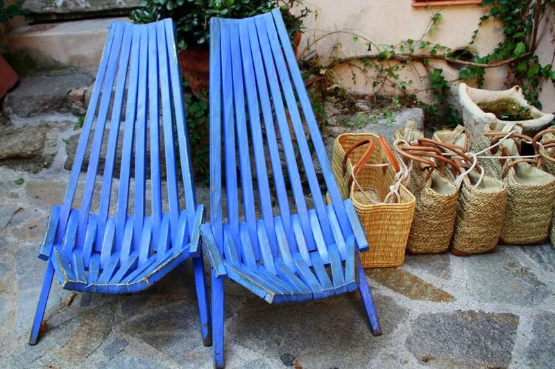 Image of old-fashioned wooden chair and wicker baskets
