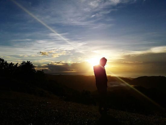 Snap A Stranger Sunlight Sunlight Adventure Full Length Nature One Person Travel Sky Photography Themes Tourism Cloud - Sky Sunbeam Beauty In Nature Politics And Government Hiking People Silhouette Sunset Landscape Vacations Social Issues