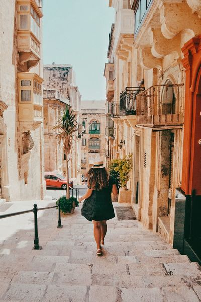 Girl walking down the streets of Valletta Vacation Trip Photo Dress Summer Days Summer Girl With Hat Hat Malta Real People Built Structure Architecture Building Exterior City Full Length Summer In The City Women Walking Lifestyles Direction Building Street Day