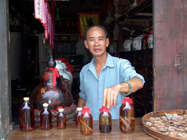 Care for some snake wine? Adult Adults Only Butcher Cheerful China Chinese Doctor Chinese Medicine Day Front View Indoors  Looking At Camera Men One Man Only One Person Only Men People Portrait Real People Smiling Snake Wine Standing Tcm Traditional Chinese Medicine