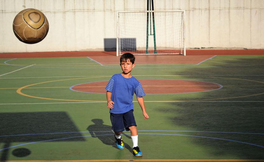 Full Length Of Boy Playing Soccer