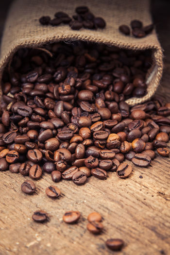 Fresh roasted coffee beans Coffee Coffee At Home Coffee Beans Coffee Break Coffee Crop Coffee Time Fair Trade Food Food Photography Fresh Roasted Coffee Wooden Background
