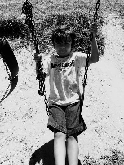 High angle portrait of boy enjoying swing