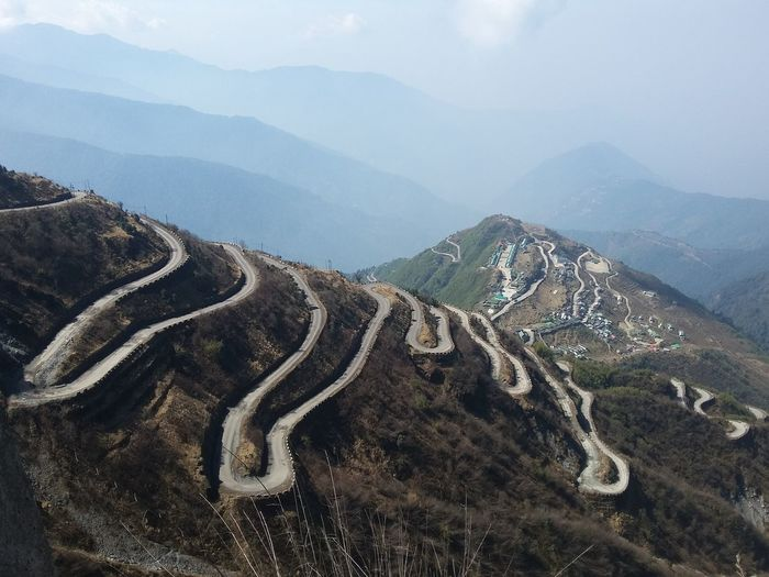 Winding roads on mountain during foggy weather