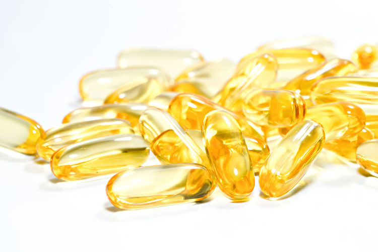 Fish oil capsule on isolated white background. Gold Liver Soft Diseases Illness Health Care Fat Buying Premium Quality Studio Pile Vitamin E Cod Liver Copy Space Capsules Close Up Medicament Concept Skin Treatment Omega 3 Nutritional Tablet Isolated Medical Dose Medication Diet Lifestyle Product Golden Pill Medicine Healthy Health Capsule Pharmacy Fish Nutrition Yellow Supplement Vitamin Drug Oil Background Care Omega Treatment Translucent White Pharmaceutical