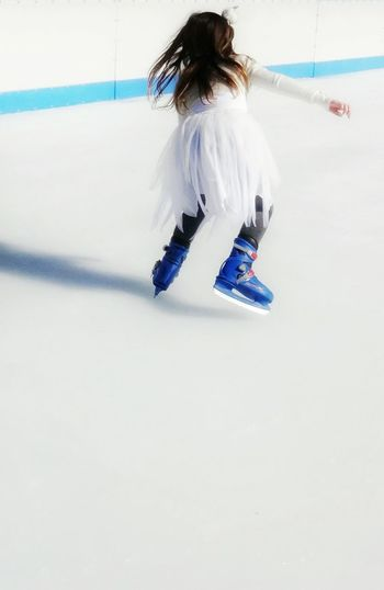 Winter Ice Rink Cold Temperature Ice-skating Leisure Activity Frozen Child Ice Skating Happy Amusement  Girl Childhood Day Skill  Ice Skate Ice-skating Winter Sport Full Length Long Hair Balance One Person