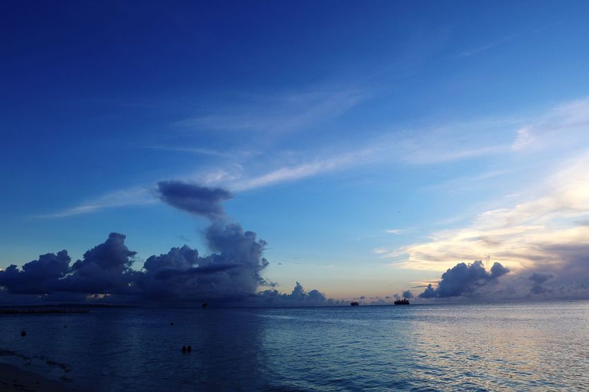Sky Water Cloud - Sky Blue Beauty In Nature Tranquility Sea Tranquil Scene Scenics - Nature Nature Smoke - Physical Structure Waterfront Pollution Environment Outdoors No People Idyllic Day Non-urban Scene Air Pollution