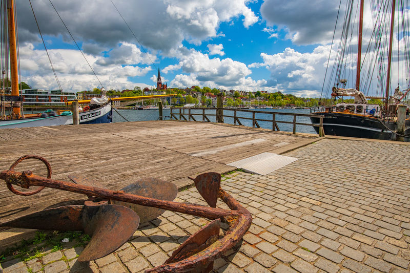 Flower Blossom Cloud - Sky Spring Countryside Village Life Village Germany Sky Water Nautical Vessel Transportation Nature Mode Of Transportation No People Day Metal Moored Rusty Rope Sea Railing Outdoors Pier Harbor Sailboat Wheel Anchor