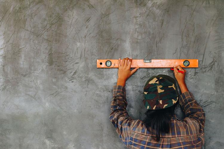 Man marking on wall