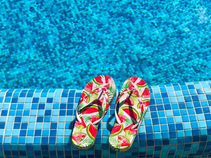 High angle view of slippers at poolside