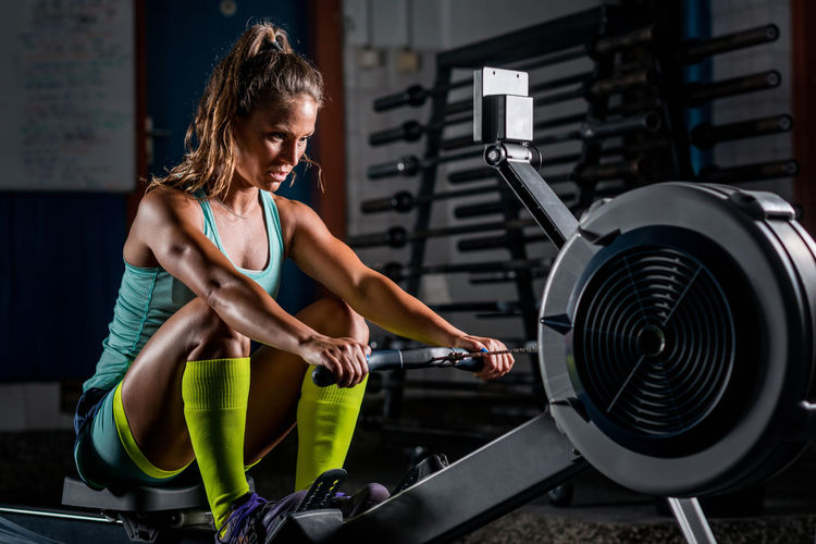 Mid Adult Woman Exercising In Gym