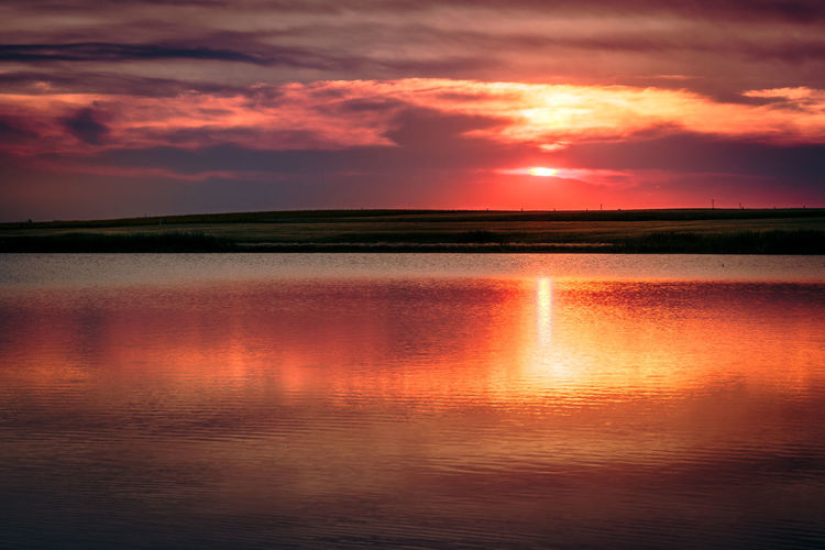 Sunset over lake Calgary,Alberta,Canada Beauty In Nature Cloud - Sky Dramatic Sky Idyllic Lake Landscape Nature No People Orange Color Outdoors Reflection Scenics Sky Sunset Tranquil Scene Tranquility Water Waterfront