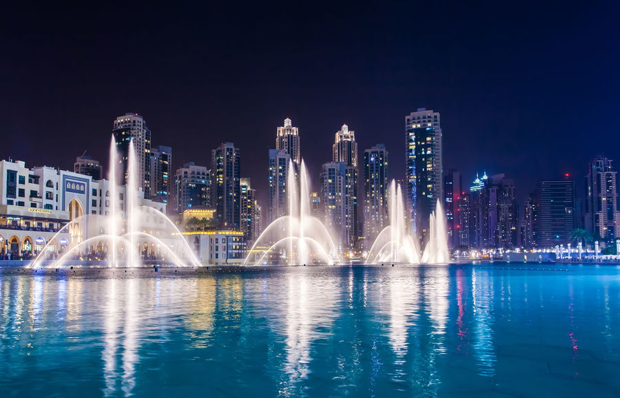 Marina Dubai Architecture Water Building Exterior Built Structure Night City Building Waterfront Reflection Illuminated Office Building Exterior Urban Skyline Sky Fountain Skyscraper Nature Cityscape Long Exposure Motion No People Spraying Modern Outdoors Swimming Pool