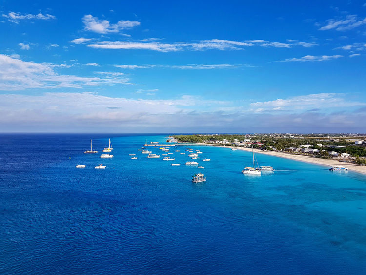 Blue Sea Water Travel Landscape Tourism Business Finance And Industry Scenics Cloud - Sky Sky Business City Travel Destinations Social Issues Outdoors Day Vacations No People Beach Nature Full Frame Vacations Caribbean Island Carribbean Caribbean Sea