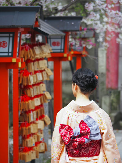 Rear View Of Woman Wearing Kimono Outside Temple
