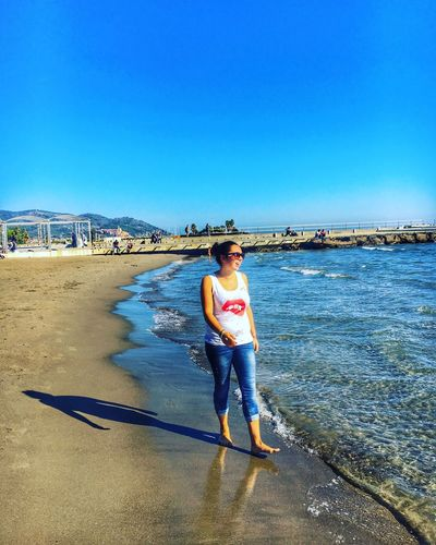 Full Length Real People Sea Blue Beach Lifestyles Water One Person Leisure Activity Outdoors Day Nature Sky Sand Horizon Over Water Standing Scenics Young Adult Italy IPhone Clear Sky HDR