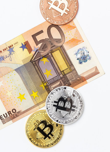 Financial concept with image of bitcoins on fifty euro banknote. Traditional money versus cryptocurrency concept. Bangkok Business Currency EUR Economy Electronic Background Banking Banknote Bill Bills Bitcoin Blockchain Buy Cash Coin Concept Crypto Cryptocurrency Cryptography Digital Euro Europe Exchange Fifty