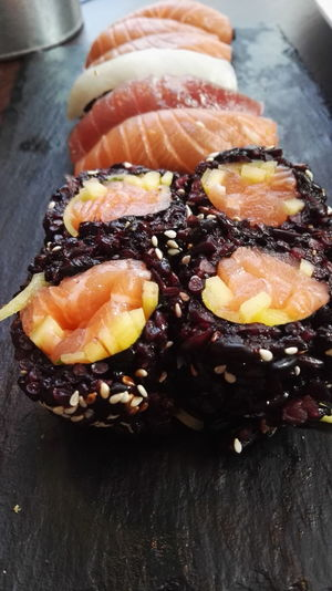 Baked Black Black Rice Close-up Dessert Food Food And Drink Freshness Gourmet High Angle View Indoors  Indulgence Meat No People Plate Ready-to-eat Rice Serving Size Still Life Sushi Sweet Food Table Temptation Unhealthy Eating