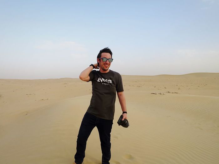 EyeEm So Fashionable 😅 Out in the desert taking the final bunch of photos from my week in Dubai. Hoping to get some of these shots (maybe even all of them) uploaded at the start of next month. I hope you are all having an awesome February, mine has been exhausting! 😋 EyeEm Going Places EyeEm Swag EyeEm T Shirt Eyeem T-shirt EyeEm In Dubai ThatsMe Fashion One Person Looking At Camera Sunglasses Portrait Front View Full Length Desert Real People Sand Beach Young Adult Lifestyles Day Happiness Outdoors Sky Smiling Sand Dune Nature One Man Only Be. Ready.