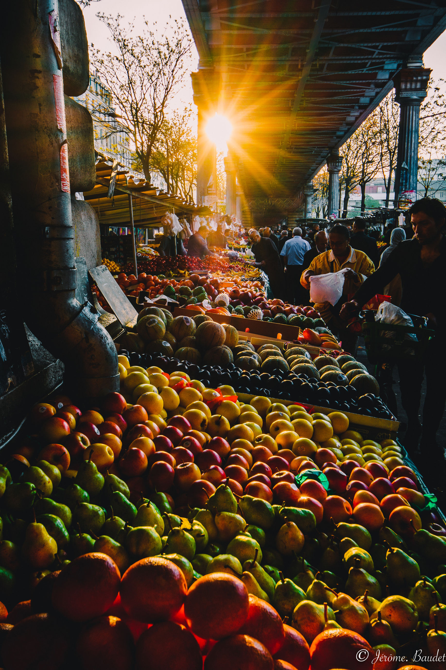 group of people, food, food and drink, real people, large group of people, healthy eating, architecture, crowd, market, retail, market stall, built structure, choice, fruit, men, illuminated, city, for sale, women, lifestyles, lens flare